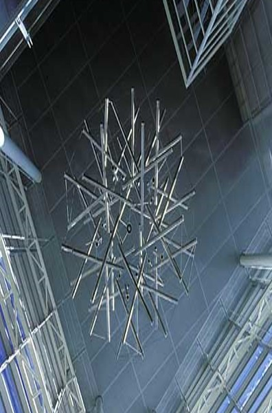 """Sixty Strut Tensegrity Sphere,"" a nine foot diameter sculpture made of stainless steel tubing and wire by R. Buckminister Fuller, hangs in the Engineering Centers Building atrium."